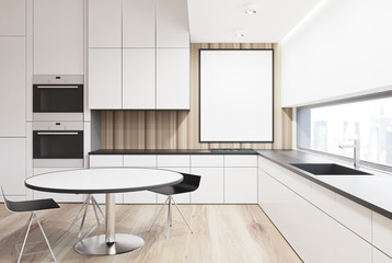 White and wooden kitchenette, round table
