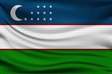 National flag of Uzbekistan on wavy fabric with a volumetric pattern of hexagons. Vector illustration.