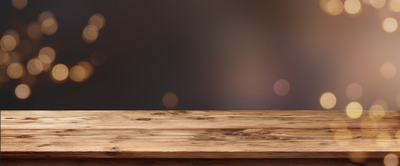 Abstract bokeh background with wooden table