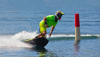 Printed roller blinds Water Motor sports Male Motosurf Competitor Taking corner at speed creating a lot of spray.