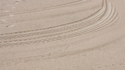 A car track in the sand on the beach