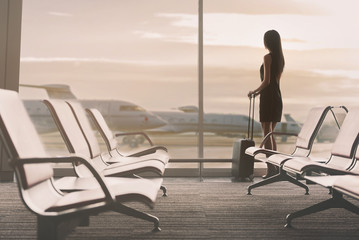 Elegant lady is waiting for flight