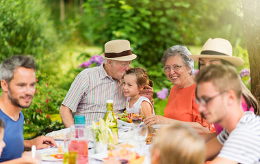 Lunch in the garden for multi-generation family