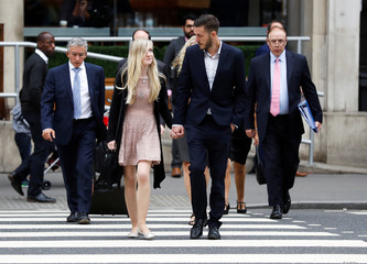 Charlie Gard's parents Connie Yates and Chris Gard arrive at the High Court ahead of a hearing on their baby's future, in London