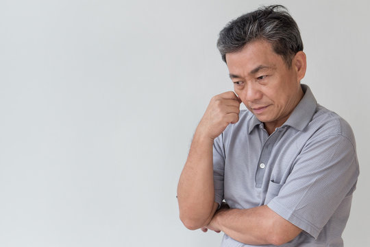 serious middle aged old senior man thinking, negative mood