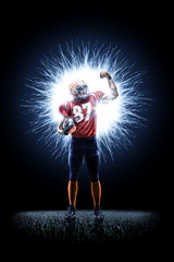 American football player in action isolated on the black