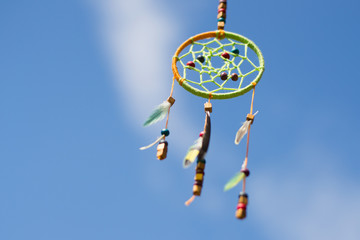 Dream catcher in the wind against the sky, selective focus