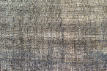 Texture of an old dark linen cloth, background