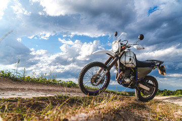 Motorcycle off road, enduro, extreme sport, active lifestyle, adventure touring concept, enduro outdoor view sky clouds freedom