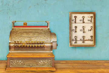 Cash register and cabinet with hotel keys and room numbers