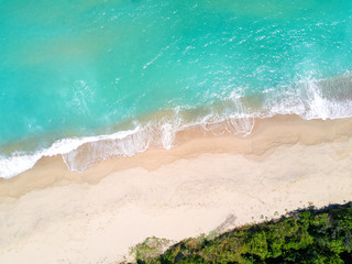 Wall Mural - Aerial view of sandy beach and ocean