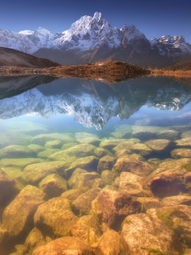 Nepal, Manaslu Region, a reflection in the Bimtang lake (3,680 m) of the Phungi peak (6,538 m) in the centre and the Mansiri Himal (7,059 m) at the left side..