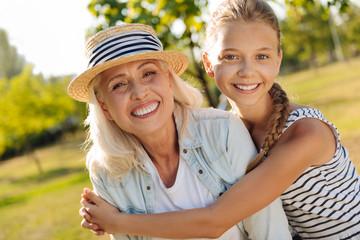 Positive little girl embracing her grandmother
