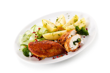 Stuffed chicken fillets and vegetables on white background