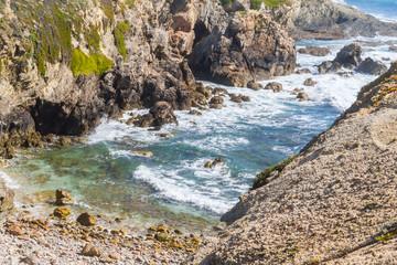 Beach between cliffs in Porto Covo