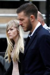 Charlie Gard's parents Connie Yates and Chris Gard leave the High Court after a hearing on their baby's future, in London