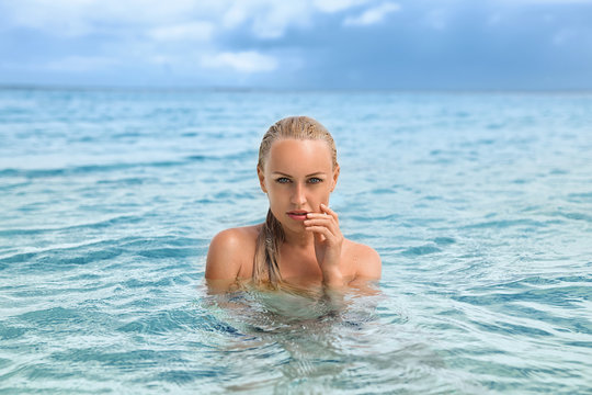 Beautiful blonde mermaid emerged from the water.