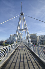 Pedestrian bridge in a modern city