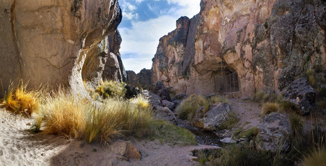 A gorge with the entrance to the Sumbay Cave, which is famous for the rupestrian art from the Paleolithic period, Arequipa departement, Southern Peru