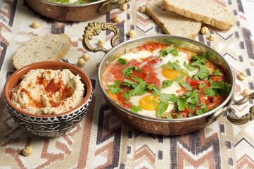 Tomato and red pepper shakshouka with hummus and wholemeal bread