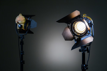 Aluminium Prints Light, shadow Two halogen spotlights with Fresnel lenses. Shooting in the Studio or in the interior. TV, movies, photos