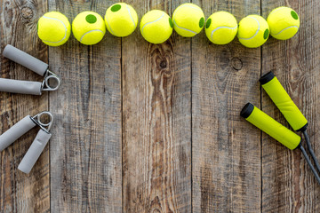 Sport gear. Jump rope and hand expander on wooden background top view copyspace