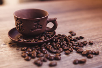 cup of coffee with roasted coffee beans, can be used as a background.