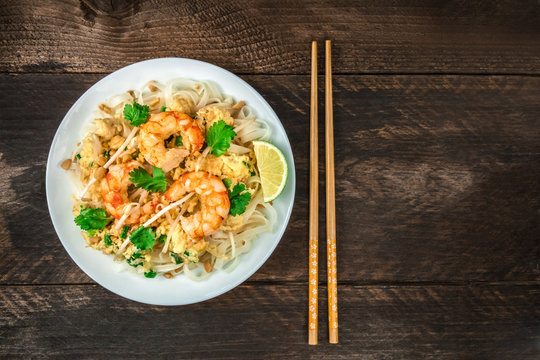 Shrimp Pad Thai closeup from above with copy space