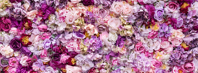 Flower texture background for wedding scene. Roses, peonies and hydrangeas, artificial flowers on the wall. Banner fow website.