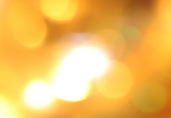 gold objects shining in the sun in blur background