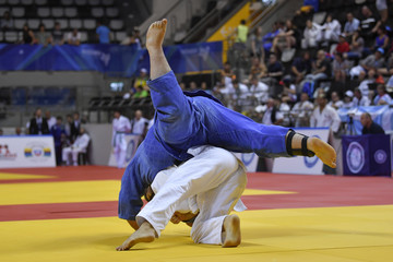 Male Judoka fighters during Judo competition