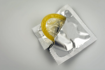 Condom close-up isolated. Contraceptive protection from  AIDS.