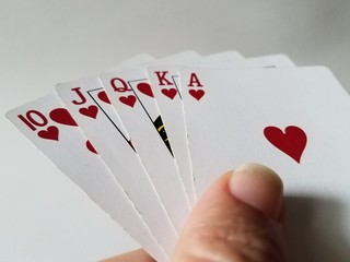 Royal flush hearts cards in hand