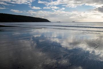 Beach scene with moody sky