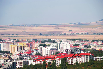 Panorama of the beautiful houses and red roofs of the Balkan mountains nature Bulgaria summer resort