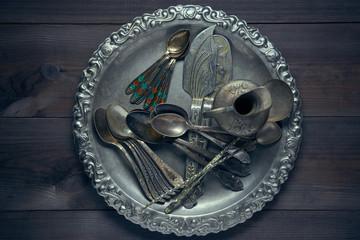 lot of vintage retro silverware utensil on a kitchen desk