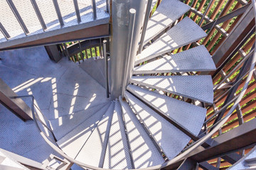 Looking down a spiral metal staircase in a modern building