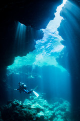 Wall Mural - Rays of sunlight into the underwater cave