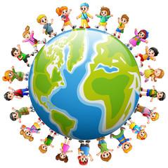 Happy group of children standing around the world