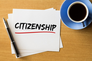 Citizenship - handwriting on papers with cup of coffee and pen, concept