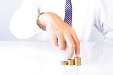 Close up of fingers walking on money coins stack for business and finance ideas concept