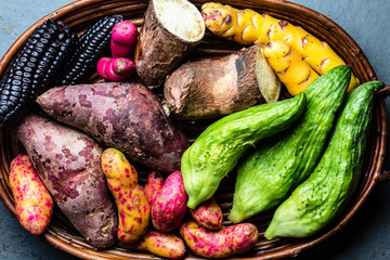 Fresh peruvian Latin American vegetables caigua, sweet potatoes, black corn, camote, yuca