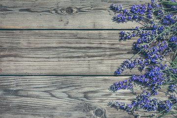 Lavender flowers from right side of wooden  background top view