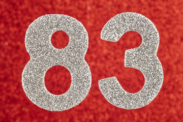 Number eighty-three silver color over a red background. Anniversary.