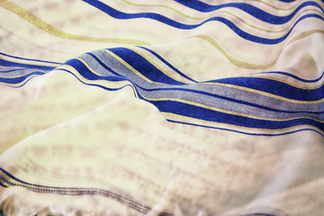 Abstract image of white Prayer Shawl - Tallit, jewish religious symbol. Double exposure concept