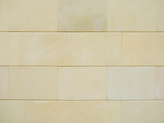 Beige sandstone wall for background