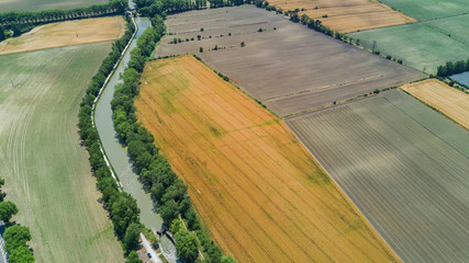 Keuken foto achterwand Olijf Aerial top view of Canal du Midi and vineyards from above, beautiful rural countryside landscape of Southern France