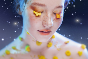 Beautiful young girl in the image of flora, close-up portrait. Fabulous portrait on a starry background