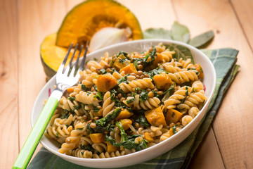 Pasta with spinach and pumpkin, selective focus