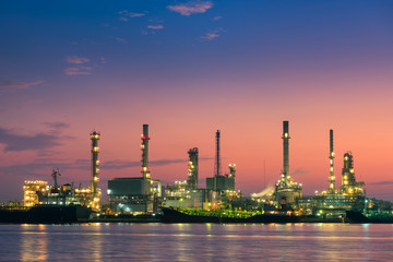 Oil refinery plant and loading dock at twilight, Morning scene